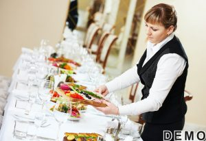 48493974 - restaurant catering services. female waitress serving banquet table