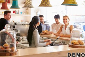 41393348 - woman ordering at the counter in a cafe