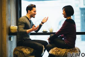 36764296 - interracial couple talking in coffee shop